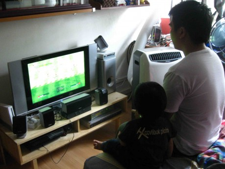 That's Winning Eleven. No fighting games till he turns 21.